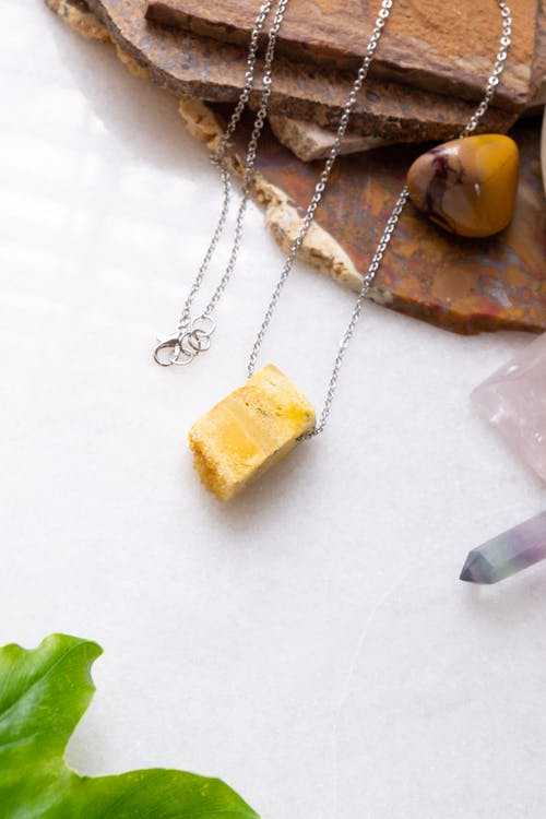 Stone Accessories on a White Table Top for a Product Shoot