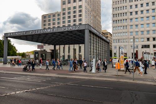 People Walking on Sidewalk Near Building