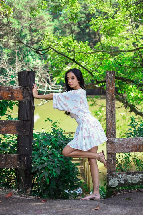 Woman Modeling and Posing While in the Park