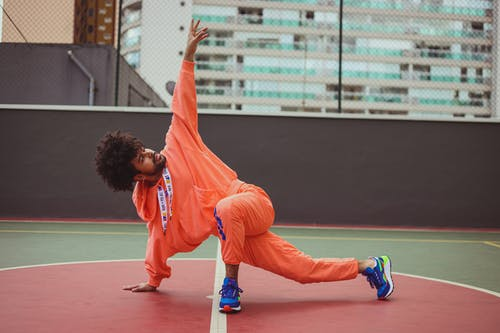 Man Breakdancing on a Concrete Court