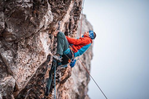 Man Climbing a Rock Mountain