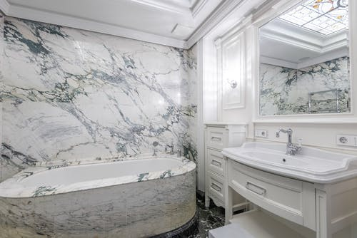 Marble Wall Bathroom with Bathtub and Sink