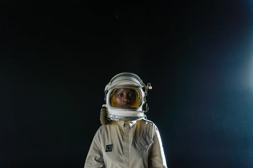 Woman in an Astronaut Suit on a Black Background