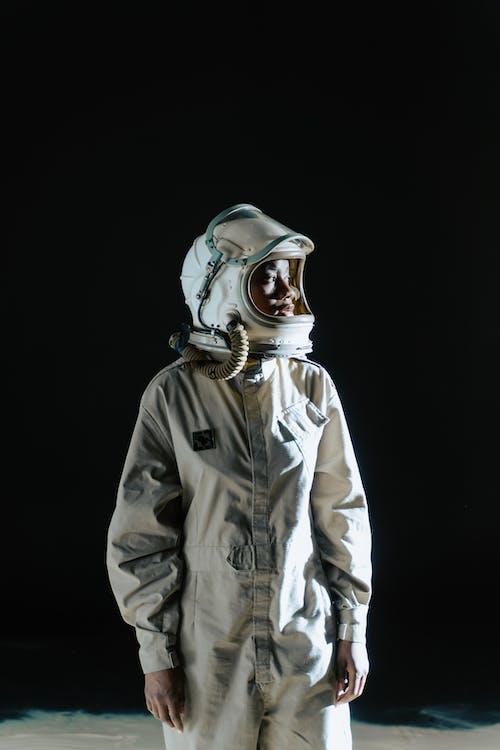 An Astronaut in Uniform Standing