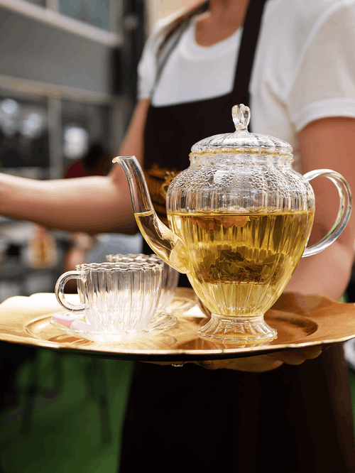 Clear Glass Teapot on White Ceramic Plate