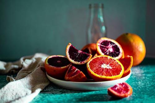 Close-Up Shot of Sliced Blood Oranges on a Plate