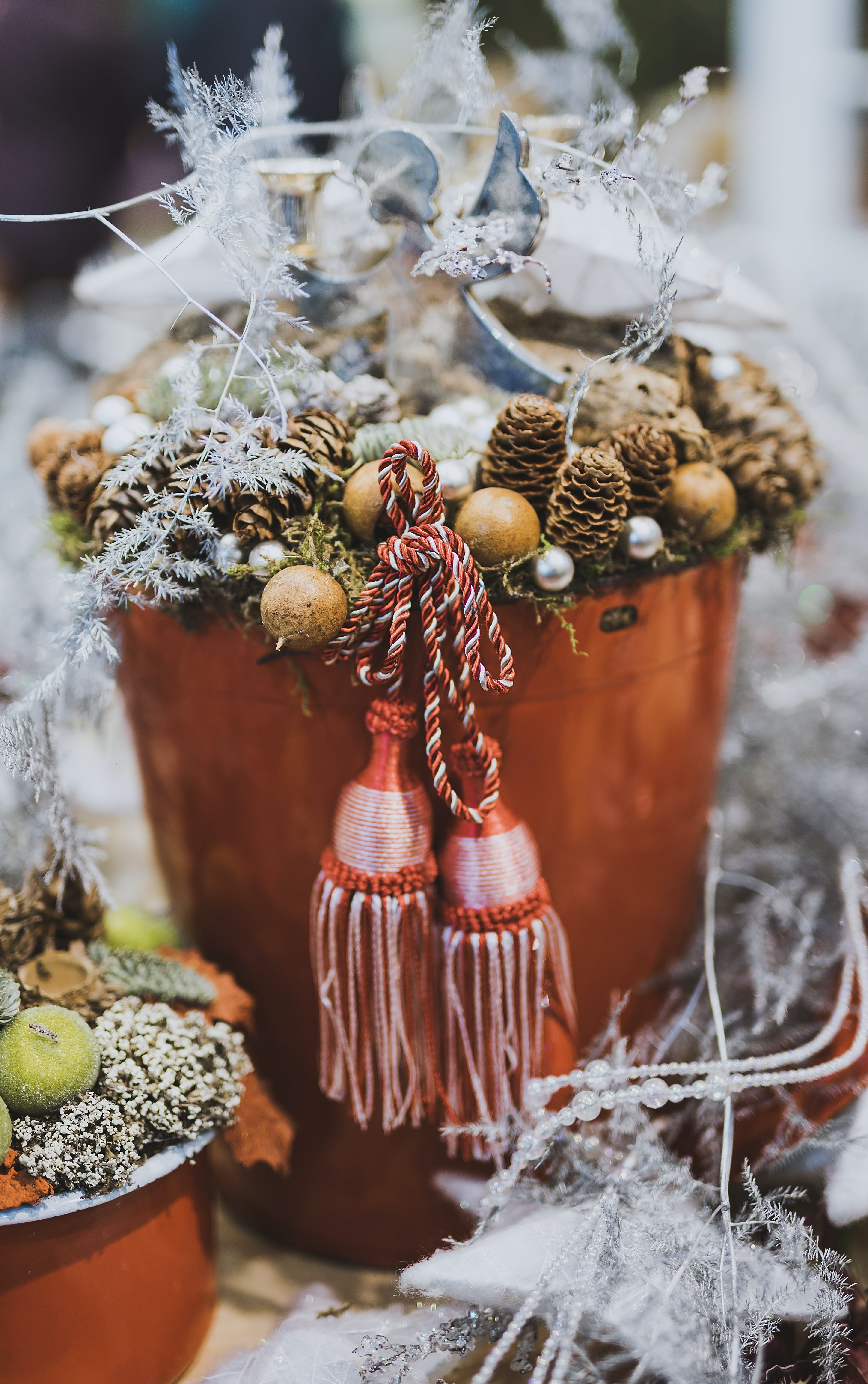 Close Up Photography of Pine Cone in Tassel Bucket