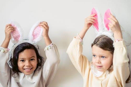 Cute diverse girls wearing bunny ears