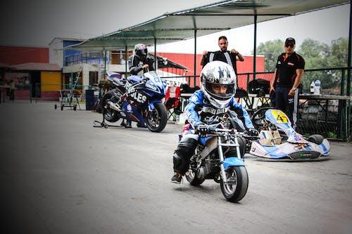 Бесплатное стоковое фото с #motorcycle #kid #racing