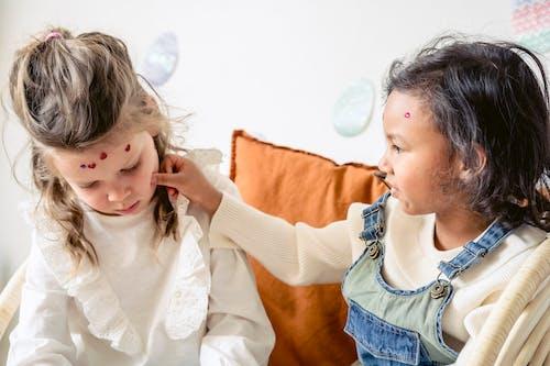 Multiethnic children having fun with stickers