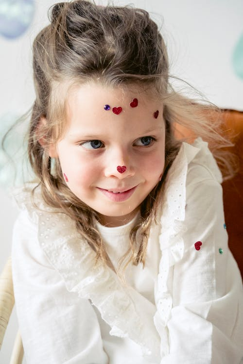 Adorable girl with decoration on face