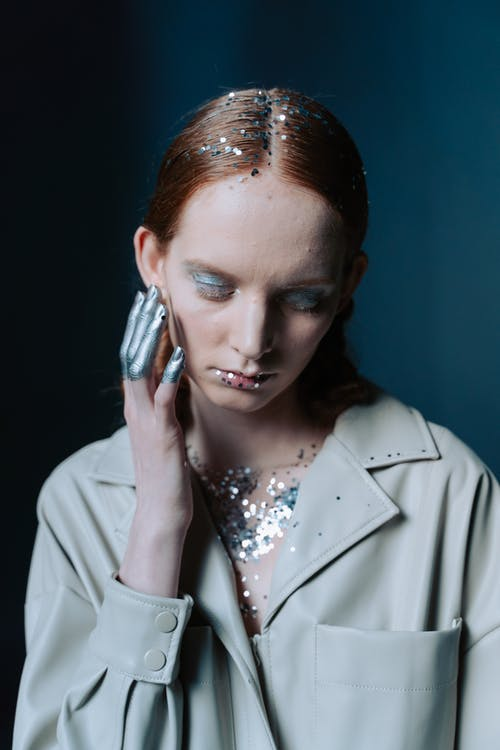 Woman Wearing Button Down Coat with Silver Sparkles All Over Her Body
