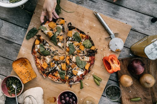 Close-Up Shot of Vegetable Pizza on a Wooden Surface