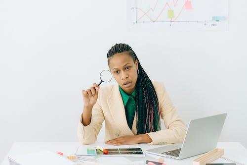 Woman in Brown Sweater Using Macbook