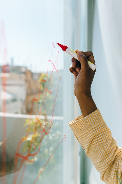 Person Holding White and Red Toothbrush
