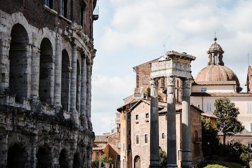 Ancient Concrete Building Under Cloudy Sky