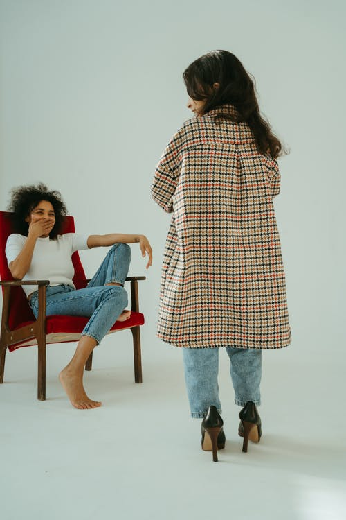 Woman Laughing at the Child Wearing Big Checkered Coat and High Heels Shoes