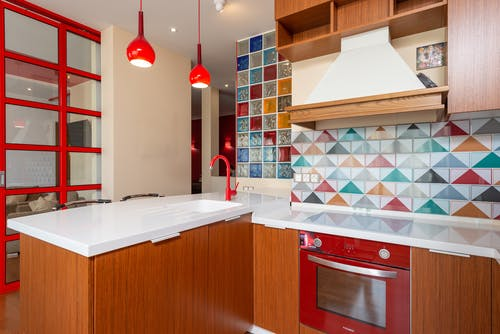 Stylish kitchen with bright furniture and tile