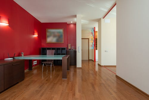 Interior of modern apartment with table and chair
