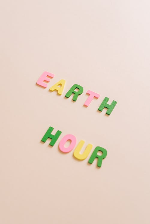 Close-Up Shot of Earth Hour Lettering on a White Surface