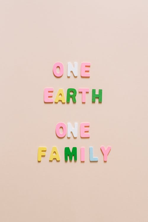 One Earth One Family Lettering on a White Surface