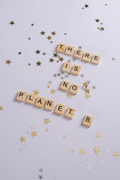 Scrabble Tiles on a White Surface with Stars