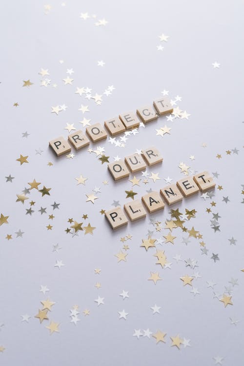 Protect Our Planet Text on a White Surface with Stars