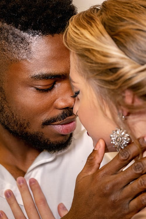 Man in White Dress Shirt Kissing Womans Cheek