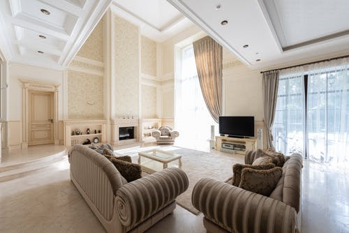 Living room interior with couches near TV and windows