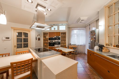 Light kitchen with furniture and appliances