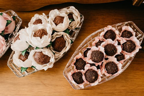 Assorted delicious chocolate truffles in decorative flowers