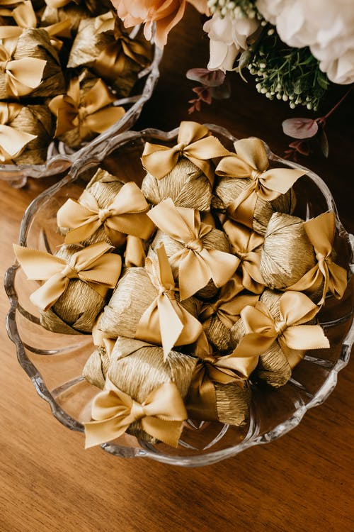 Decorative cloth gift bags with bows on stand