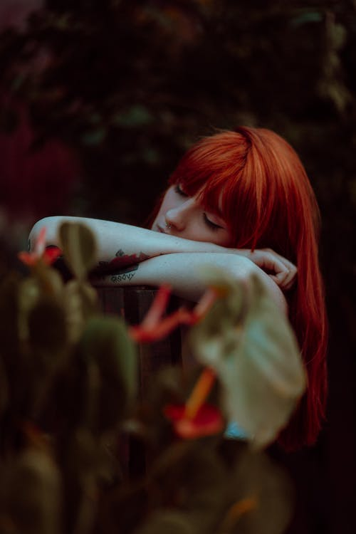 Woman With Red Hair Holding White Bird