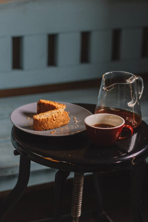 Delicious sweet cake served with tea in glass kettle