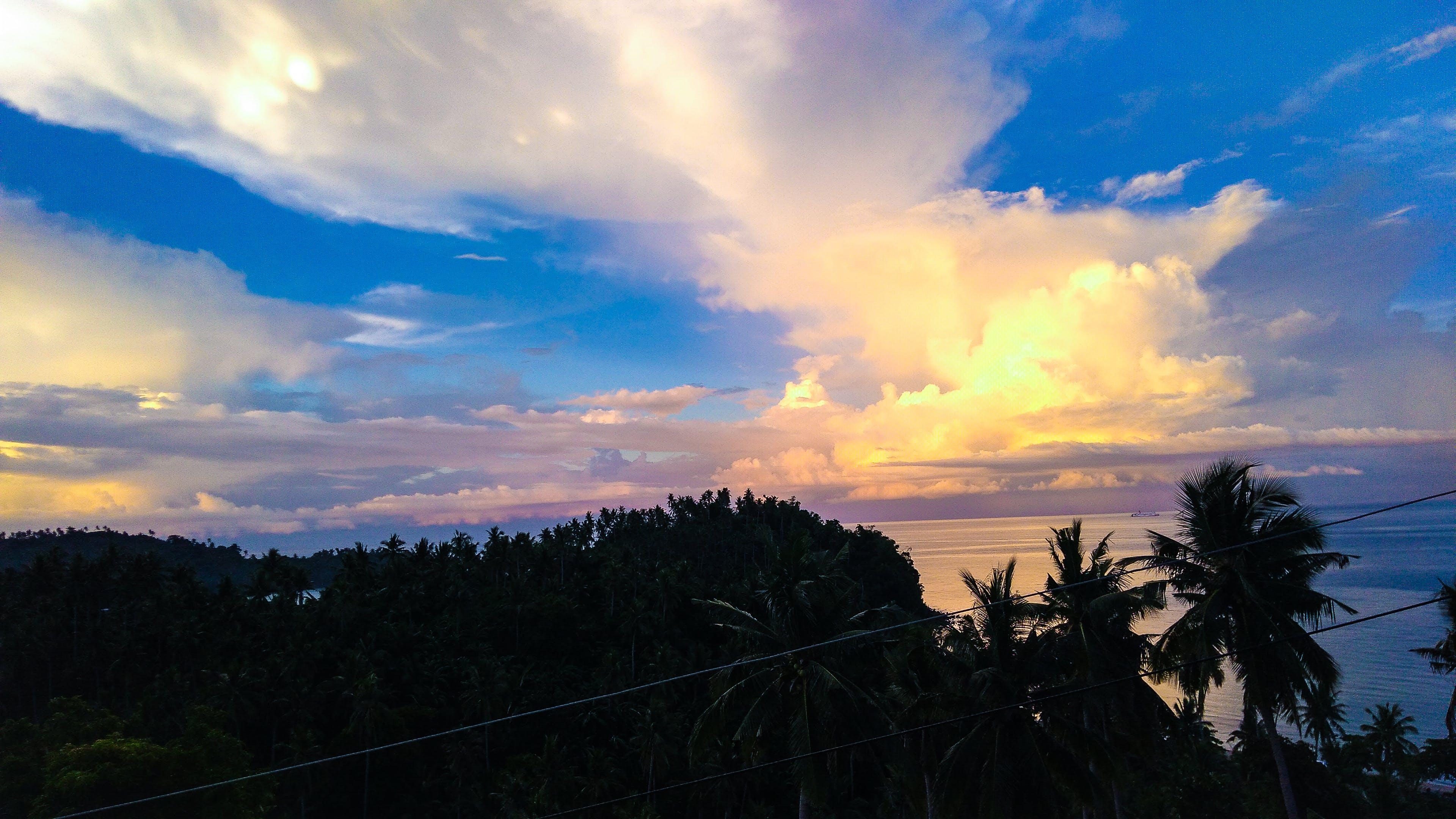 Foto d'estoc gratuïta de cel, cel blau, mar blau, muntanya