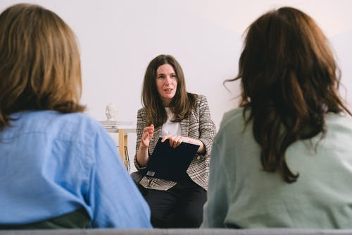 Woman discussing details of project with clients