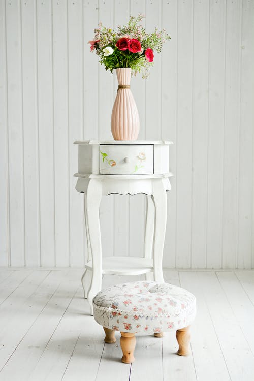 White and Pink Floral Ceramic Candle Holder on White Wooden Table