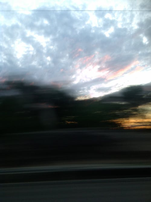 Free stock photo of clouds, grey sky, road blur, sunset