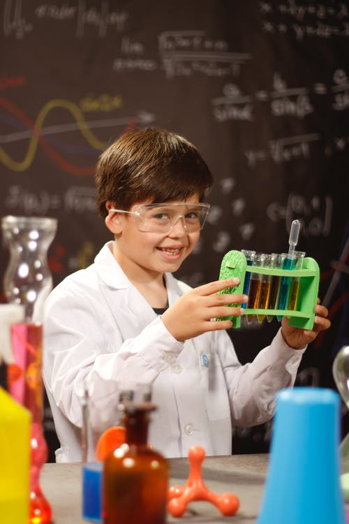 A Boy Holding a Science Experiment