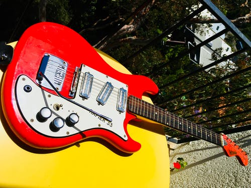 Free stock photo of electric guitar, red guitar, yellow table