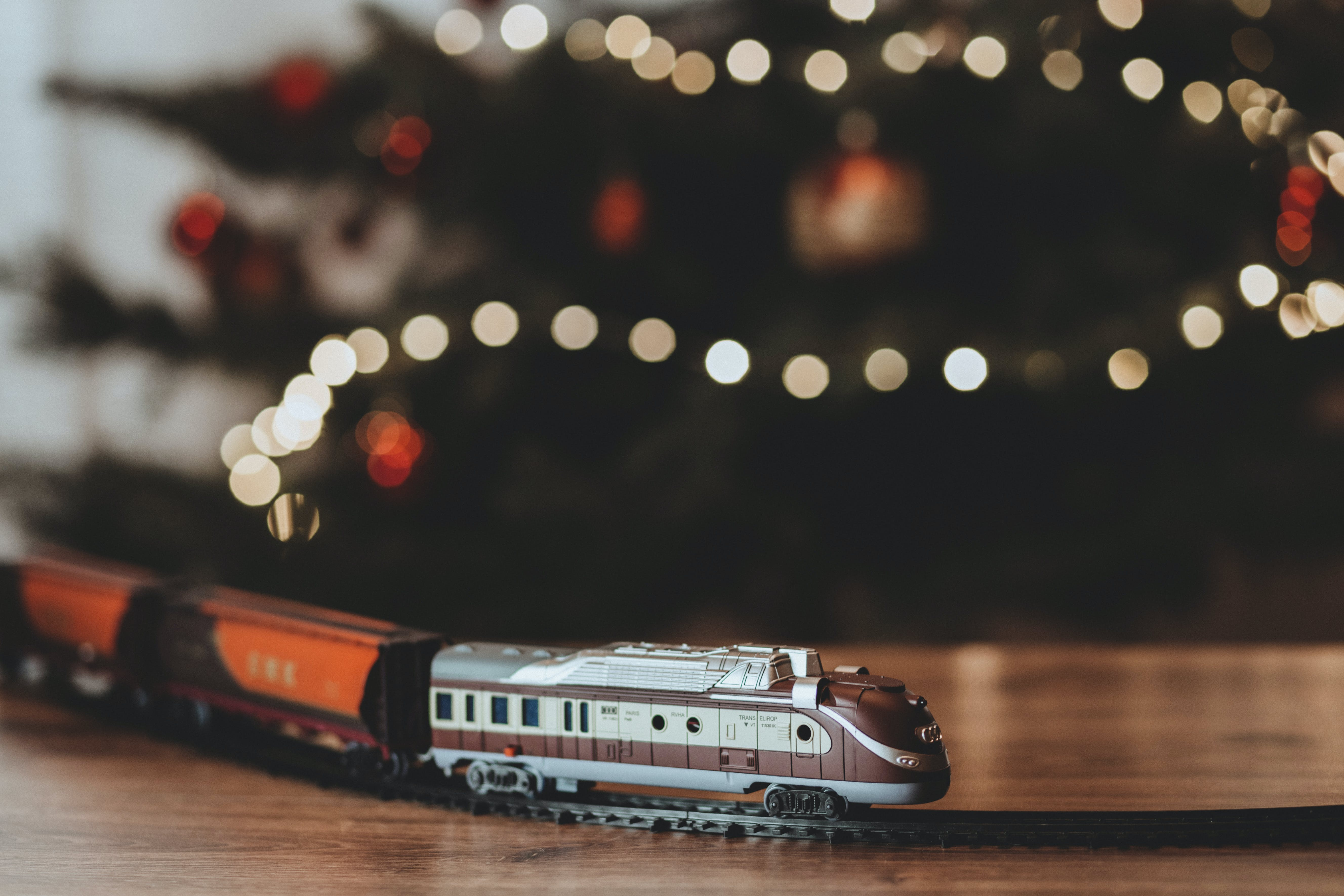 Shallow Focus Photography on Gray Train Plastic Toy