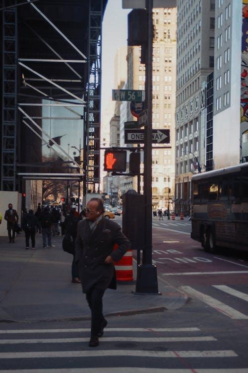 People Walking on Pedestrian Lane in Downtown Area