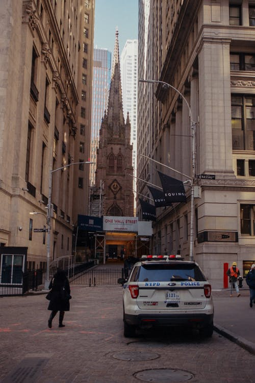 Police Car Parked on Wall Street