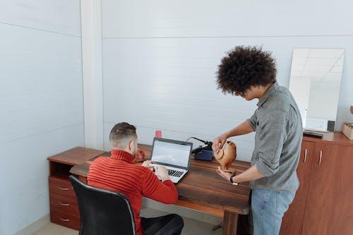 Men Designing an Electronic Figurine