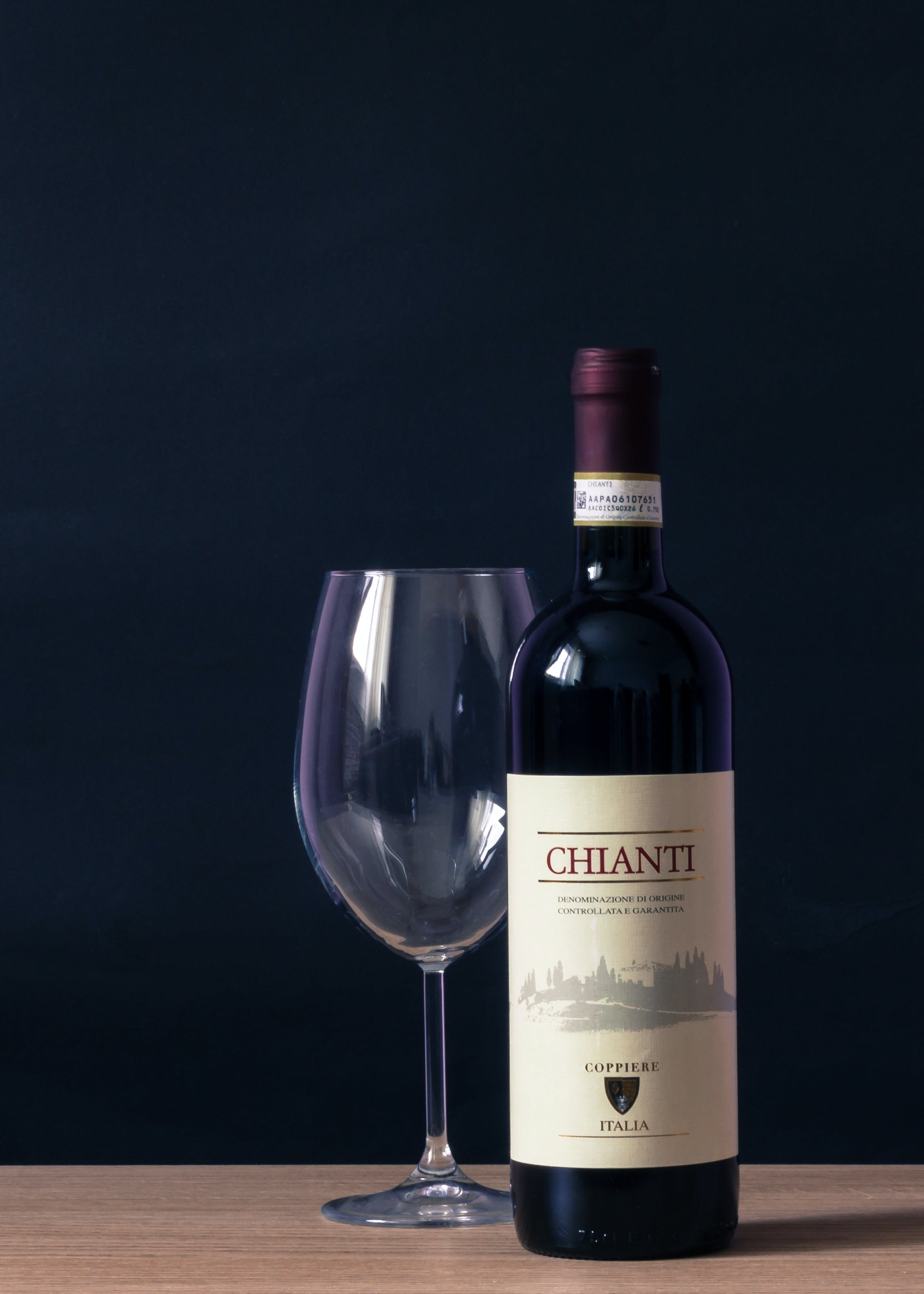 Chianti Labeled Bottle and Clear Long Stem Glass on Table