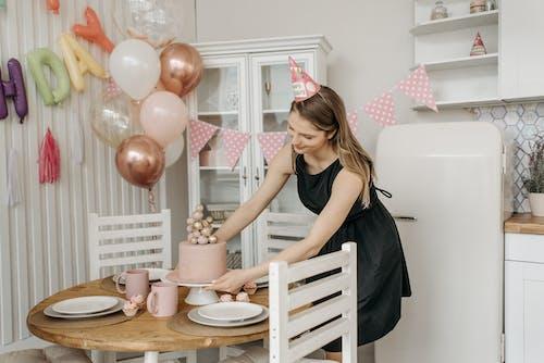 Woman Preparing for a Birthday Celebration