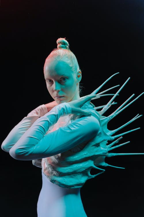 Woman Wearing a Spiky Costume Looking at Camera