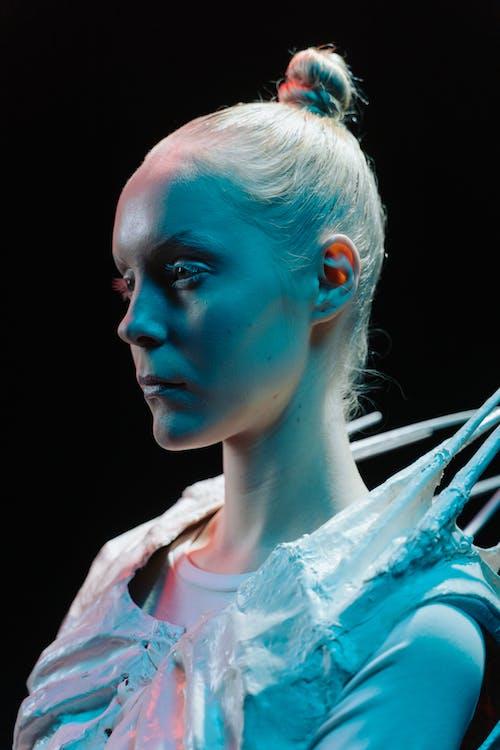 Woman in Alien Costume Lit by Studio Lights