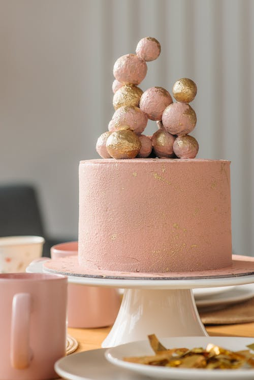 Birthday Cake on a Dinner Table