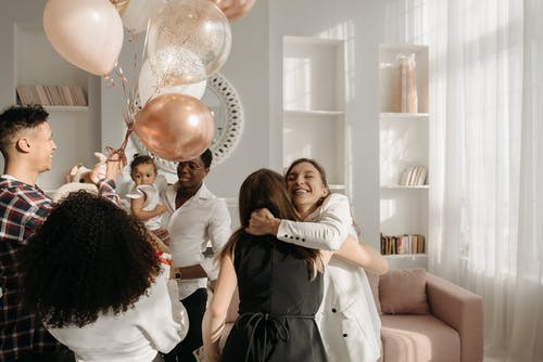 Women Hugging in the Birthday Party Celebration